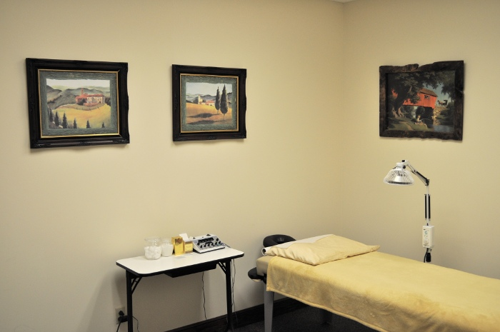 One of the patient rooms with a bed, IR lights, and some medical equipment.